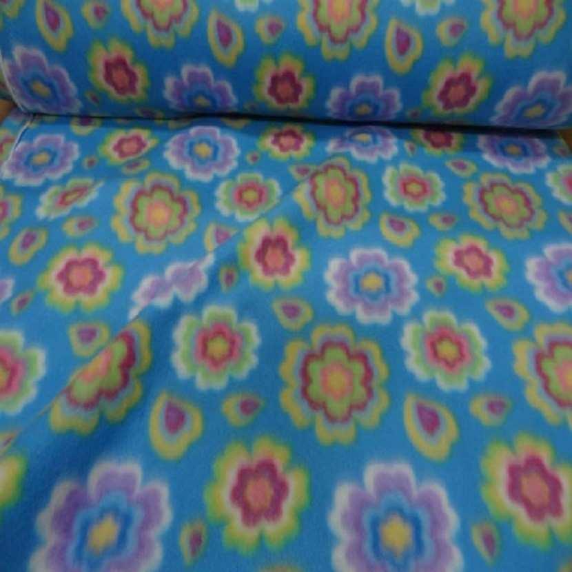 Polaire avec touche doudou bleu a motifs fleurs 1