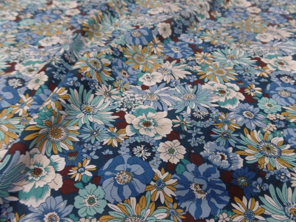 Popeline coton 100 imprime fleurs ton bleu blanc vert