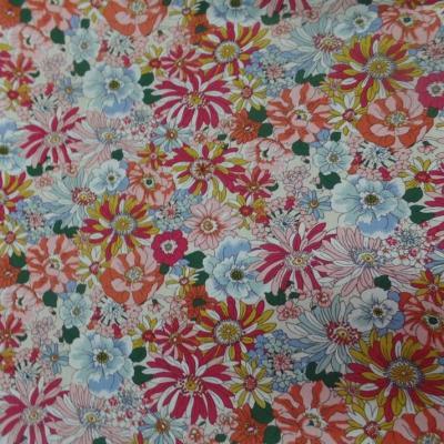 Popeline coton 100 imprime fleurs ton rouge orange bleu