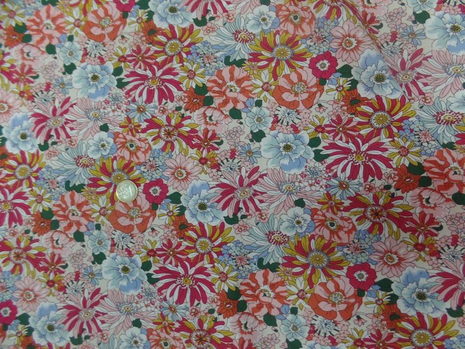tissu popeline coton 100% imprimé fleurs ton rose pastel