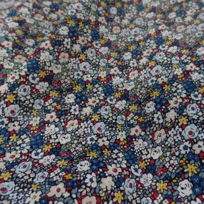 Popeline coton imprime liberty fleurs blanc bleu jaune et rouge