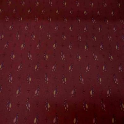 Popeline coton lycra imprime ton bordeaux motifs plumes