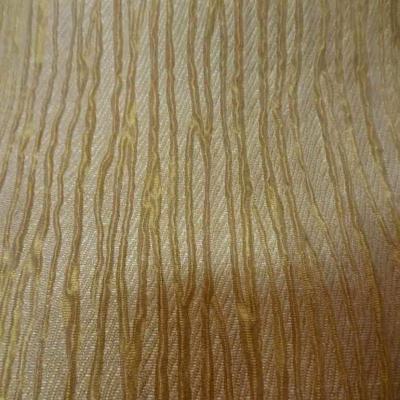 Soie 100 faconne plisse dore