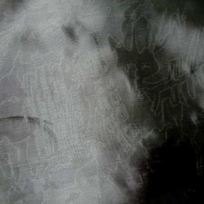 Taffetas 100 soie gris faconne