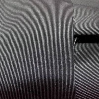 Taffetas lycra noir a fine rayures gris metal