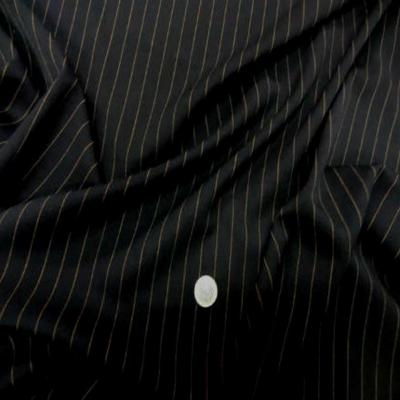 Tergal stretch noir a rayure cuivre