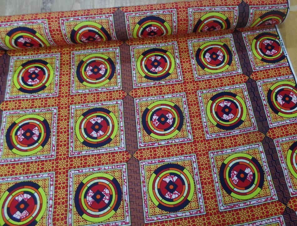 vente de tissu africain Wax rouge imprimé jaune ,noir au mètre sur MARSEILLE