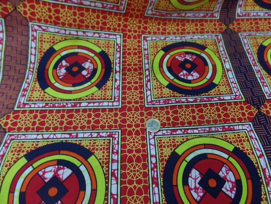 vente de tissu AFRICAIN WAX rouge imprimé jaune ,noir au mètre