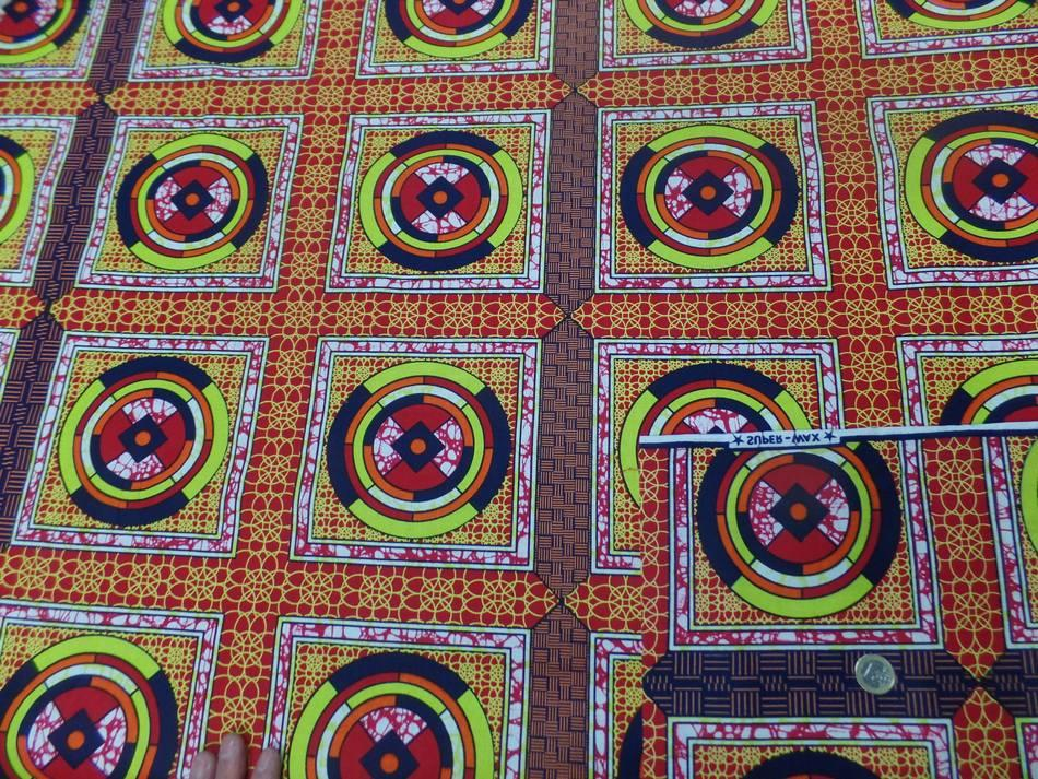 vente de tissu africain Wax rouge imprimé jaune ,noir au mètre pas cher