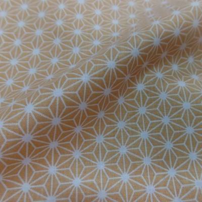 Tissu coton 100 cretonne imprime geometrique jaune safran et blanc en 1 45m de l