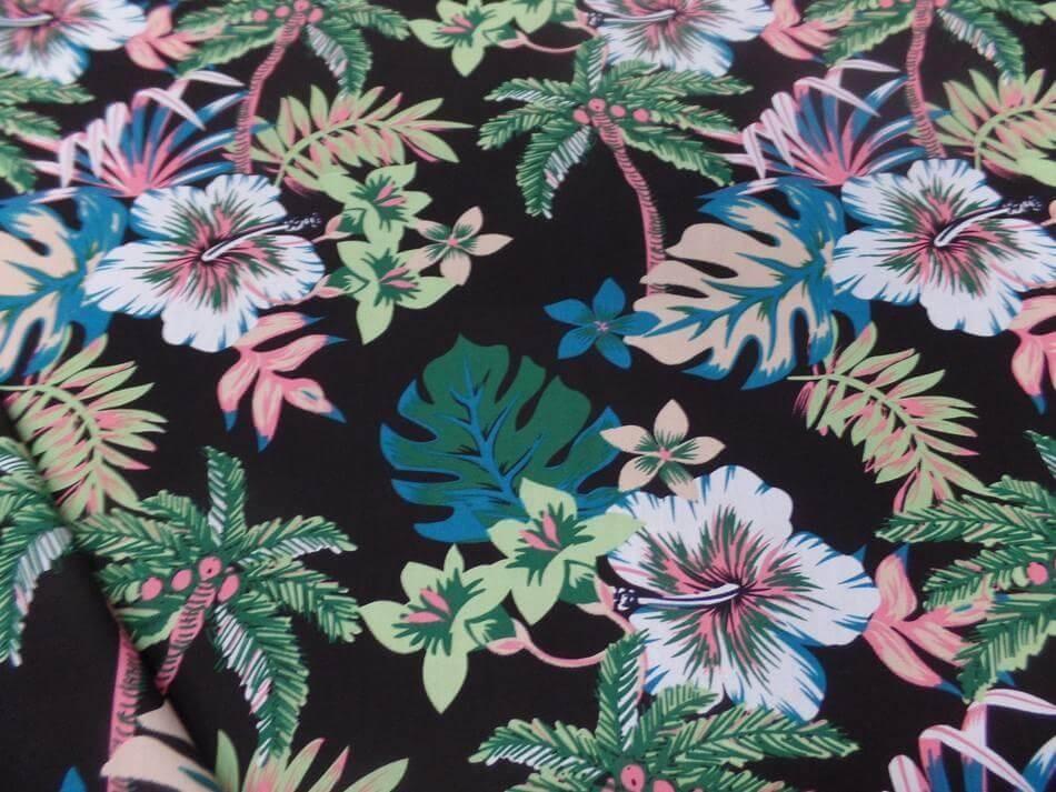 Tissu coton popeline noire imprime hawaïen ton vert blanc bleu