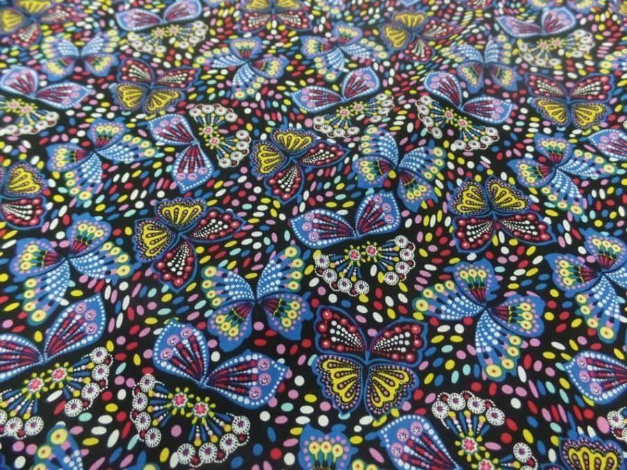 Tissu coton popeline noire imprime liberty papillon jaune bleu rouge