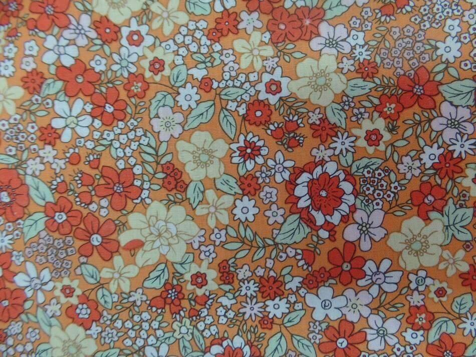 Tissu coton popeline orange imprime liberty motifs petite fleurs