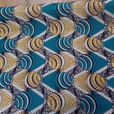 Tissu coton wax motifs africain ton blanc bleu jaune