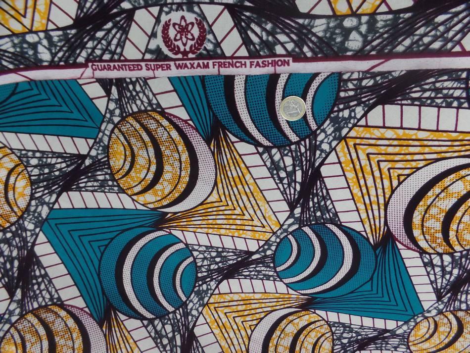 vente de tissu coton Wax motifs Africain ton blanc ,bleu ,jaune  pas cher