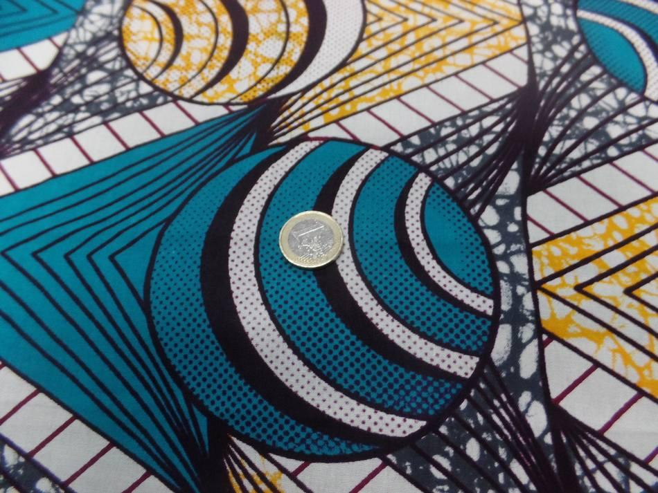 vente de tissu coton Wax motifs Africain ton blanc ,bleu ,jaune au mètre