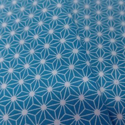 Tissu cretonne imprime geometrique bleu et blanc