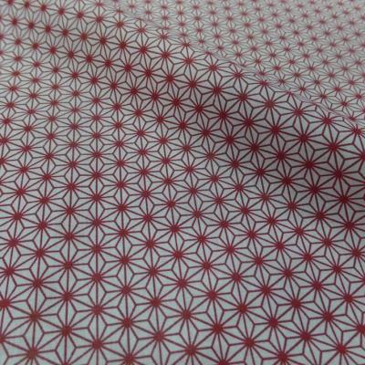 Tissu cretonne imprime geometrique rouge et blanc