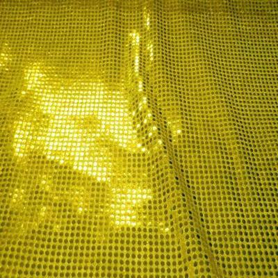 Tissu jaune a paillettes ronde dore