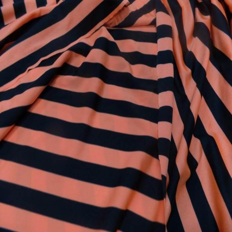 tissu lycra extensible dans les 2 sens satiné a rayure noire et orange