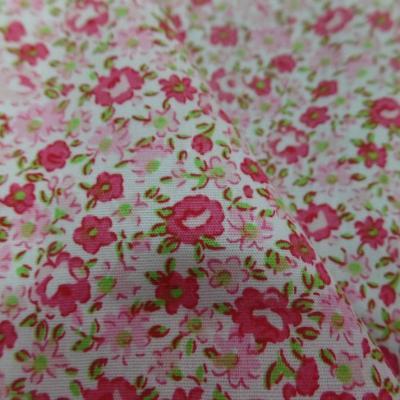 Tissu popeline coton blanche imprime liberty fleurs rose et vert