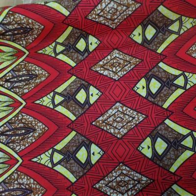 tissu wax rouge bordeaux imprimé poissons ton noir ,jaune et marron