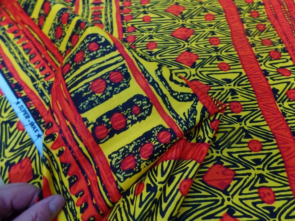 vente de tissu africain wax imprimé ton jaune ,noir et orange sur Marseille