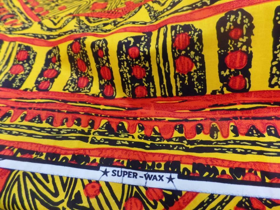 vente de tissu africain wax imprimé ton jaune ,noir et orange au mètre