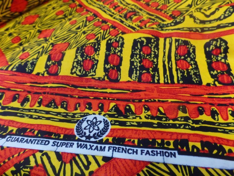 vente de tissu africain wax imprimé ton jaune ,noir et orange en ligne