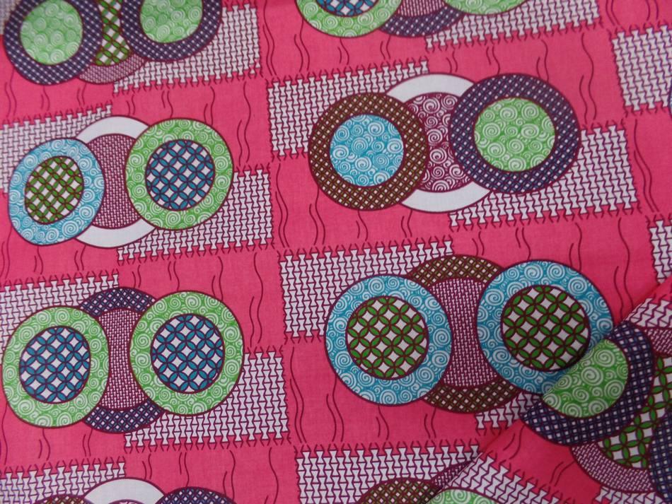achat tissu wax rose a motifs rond ton blanc ,bleu ,vert ,bordeaux