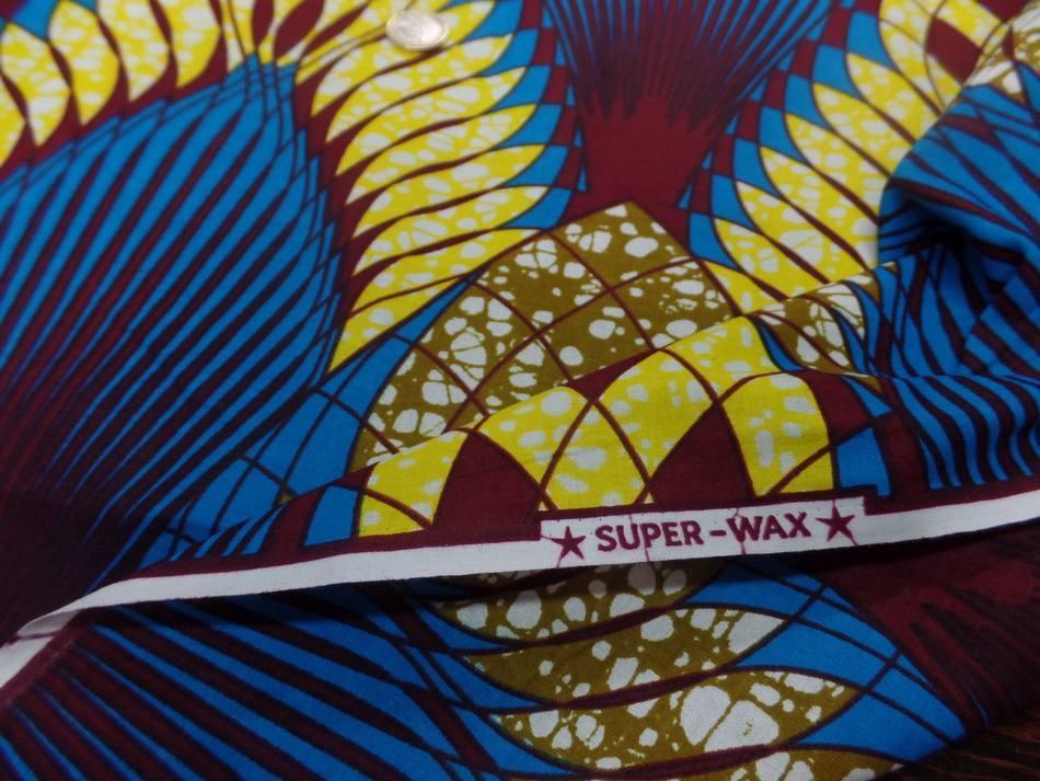 vente de Tissu wax imprimé ton bleu jaune bordeaux au mètre