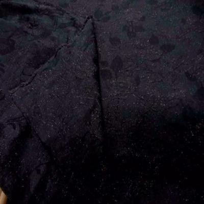 Toile legere noire faconne tweed et brode