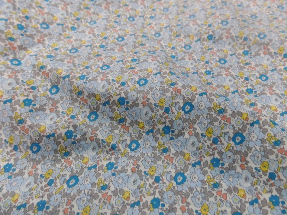 Vente de tissu coton popeline blanche imprime style liberty fleurs bleu jaune taupe en ligne