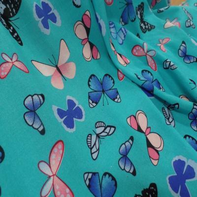 Viscose bleu fine imprime papillon bleu et rose