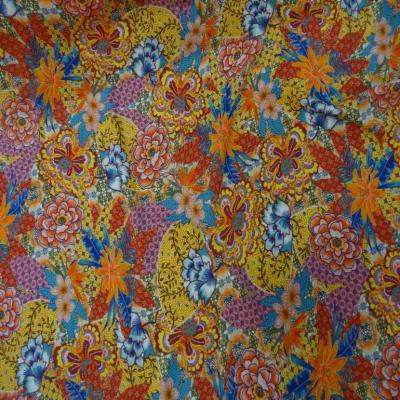 Viscose imprime ton rouge orange rose et bleu