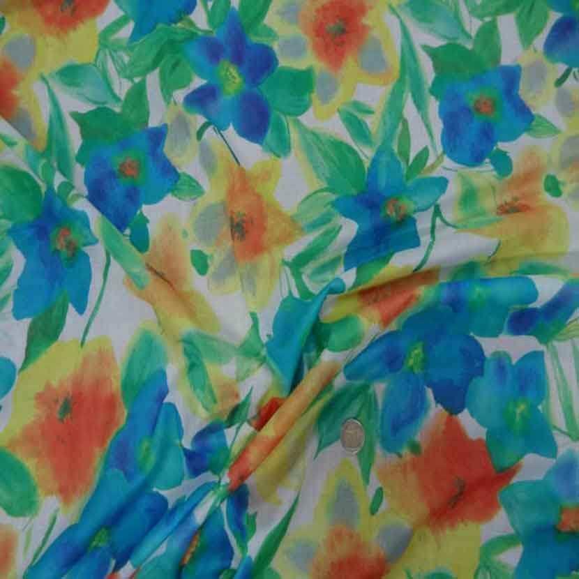 vente de voile coton soie blanc imprimé fleurs ,bleu ,jaune ,orange