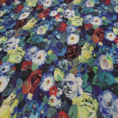 Tissu Voile de coton soie sur fond bleu imprime fleurs