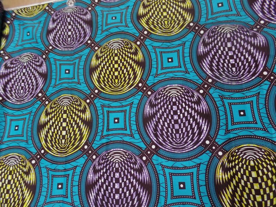 vente de tissu wax bleu turquoise imprimé jaune ,marron et lavande