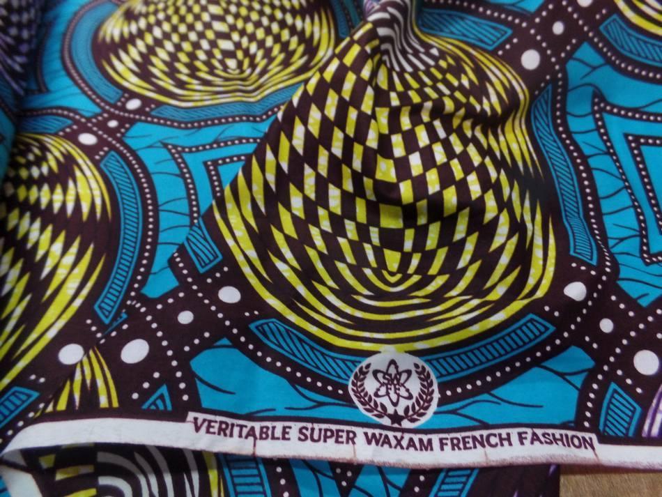 tissu wax bleu turquoise imprimé jaune ,marron et lavande